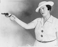 lady-with-gun-vintage-photo