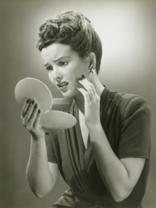 woman-looking-in-mirror-vintage