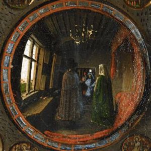 Detail of The Arnolfini Portrait by Jan van Eyck: a couple, viewed from behind, are reflected in a round mirror