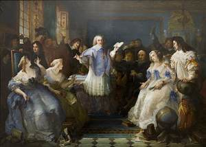 A painting of a French literary salon in the 17th century. A woman, center, is reading aloud as other guests sit around her.